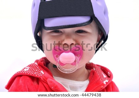 baby with safety helmet - stock photo