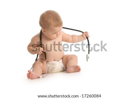 Baby with stethoscope on white background - stock photo