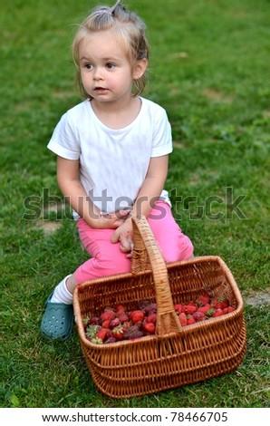 baby with strawberries - stock photo