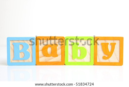 baby written with wooden alphabet blocks - stock photo