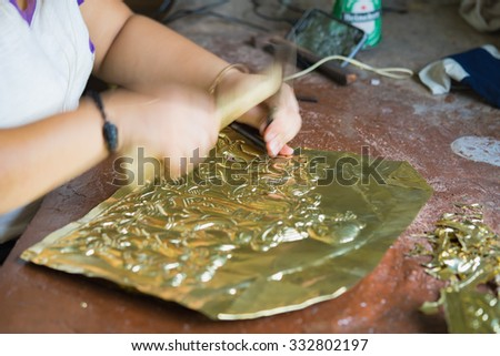 Bac Ninh, Vietnam - Sep 12, 2015: Copper handicraft products are making by craftsmen in traditional way (hand work) in Dai Bai village. Junior people are major labors in traditional works in Vietnam - stock photo