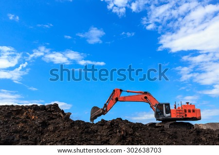 Back hole and Coal in Blue Sky - stock photo