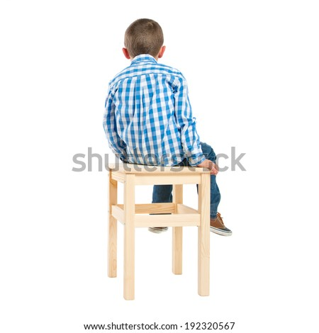 back kid on wooden chair over white background - stock photo
