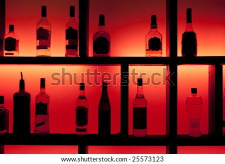 Back lit bottles in a cocktail bar - stock photo