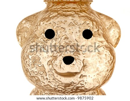 Back lit empty honey jar over a white background showing an interesting residue texture - stock photo