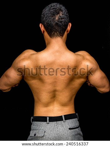 back muscle of bodybuilder - stock photo