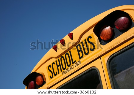 Back of a school bus with copy space - stock photo