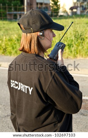 back of a security guard - stock photo