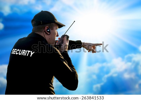back of a security guard isolated on white - stock photo