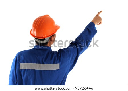 Back of asia worker man pointing up isolated on white background - stock photo