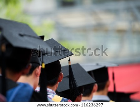 back of graduates during commencement. - stock photo