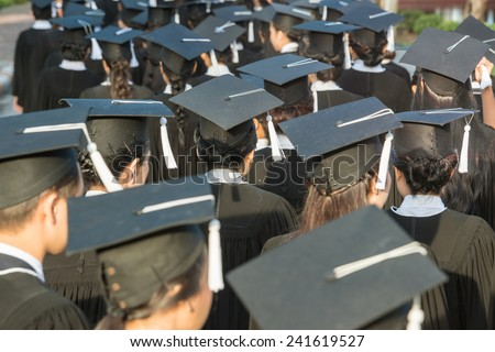 back of graduates during commencement - stock photo