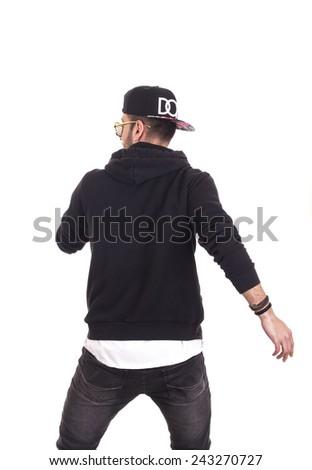 Back of guy dancing wearing hoodie and black cap - stock photo