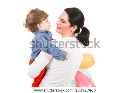 Back of mother looking to toddler boy and holding balloons isolated on white background - stock photo