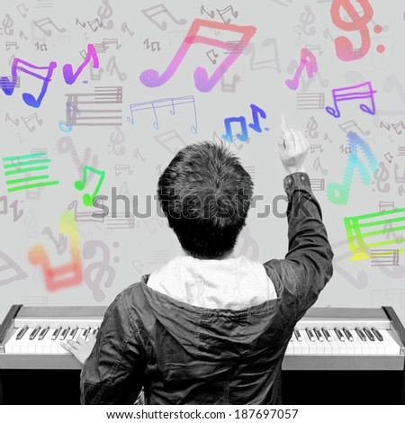 back of musician composing the music note on the imagination , B&W processed human and piano - stock photo
