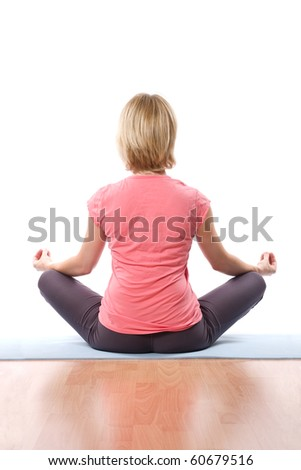 Back of relaxing Young woman practise yoga - stock photo