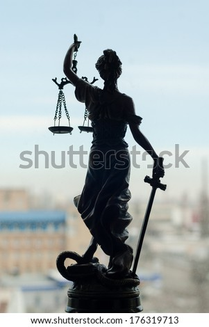back of sculpture of themis, femida or justice goddess on white - stock photo