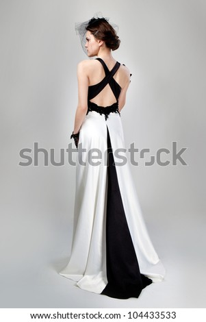 back of the girl in a cocktail dress. studio shooting. - stock photo