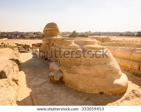 Back of the Great Sphinx of Giza, a limestone statue of a creature with a lion's body and a human head), Giza Plateau, West Bank of the Nile, Giza, Egypt - stock photo