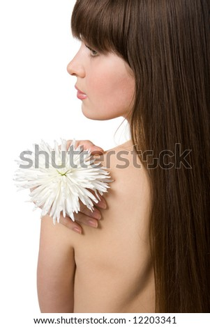 Back of the naked attractive brunette with chrysanthemum isolated on white - stock photo