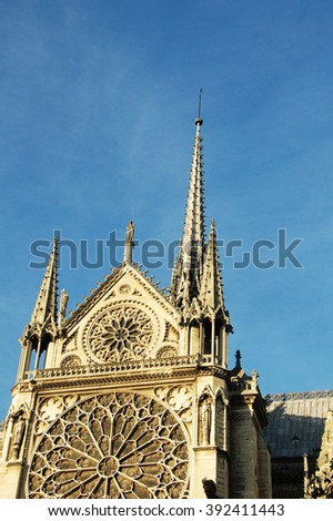 Back of the Notre Dame cathedral with a stained window, Paris, France - stock photo