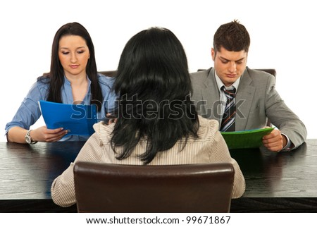 Back of woman having interview with two business people and sitting all on chairs - stock photo