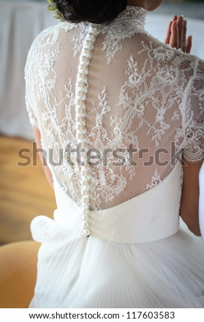 Back of young bride on wedding day - stock photo