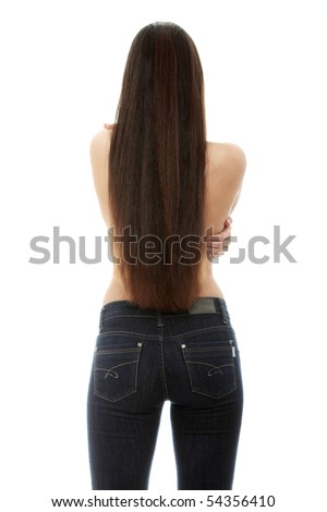 Back of young woman with long hairs dressed in jeans - stock photo