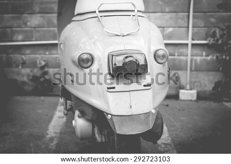 Back part of scooter in car park,Black and white vintage tone and retro style.  - stock photo