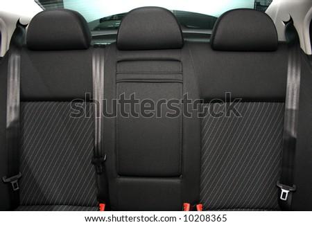 Back passenger seats in a modern car - stock photo