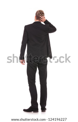 Back-pose of a corporate person thinking. Isolated over white background - stock photo