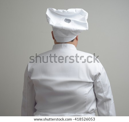 back, rear side of chef - stock photo