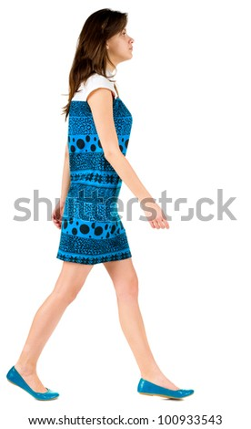 back side view of going brunette girl in blue dress. beautiful woman in motion.  backside view of person. Isolated over white background. Rear view people collection. - stock photo