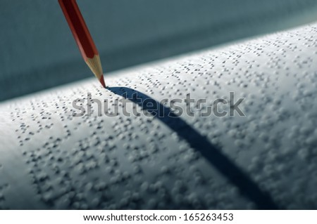 Back to light through Braille language concept.(Shallow DOF) - stock photo