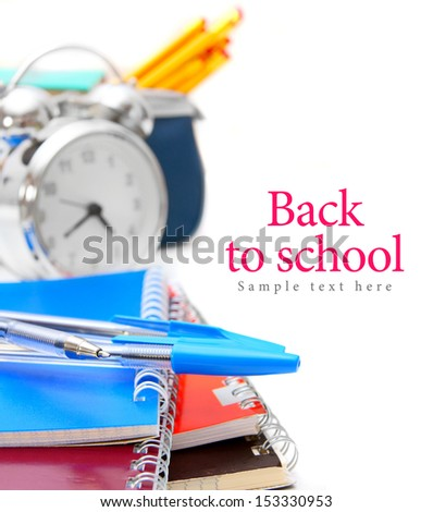 Back to school. An alarm clock and school accessories on a white background. - stock photo