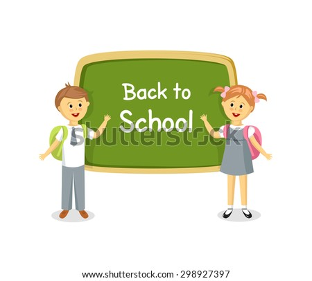Back to school. Boy and girl standing near school board - stock photo