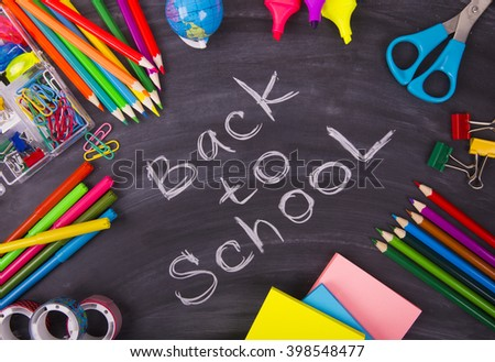 Back to School chalkboard and school supplies - stock photo