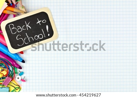 Back to School chalkboard tag with school supplies side border on graphing paper background - stock photo
