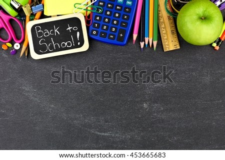 Back to School chalkboard tag with school supplies top border on blackboard background - stock photo