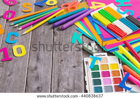 Back to school concept on wooden background - stock photo