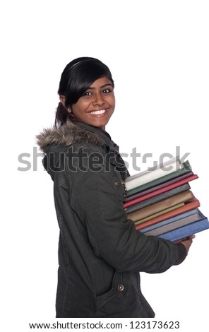Back to School: Dark Indian/ Asian college student holding a pile of books over isolated white background. - stock photo