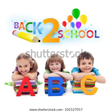 Back to school - happy kids with books and letters, isolated - stock photo