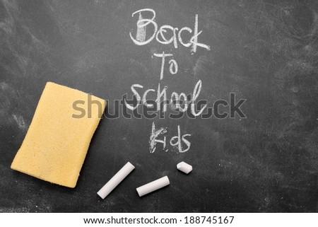 Back to school kids sketch on black chalkboard - stock photo