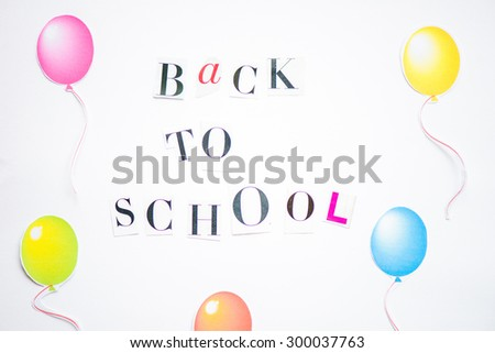 Back to School Letters cut out from the Magazine with colourful balloons nearby - stock photo