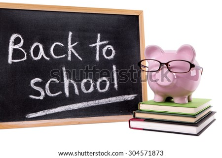 Back to school message, piggybank, blackboard, isolated on white background - stock photo