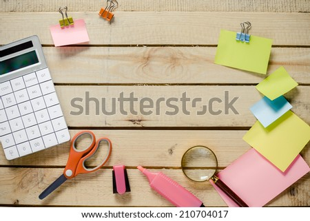 Back to school. Notebook , colored pencils, back to school concept surface with copy space over wooden background - stock photo