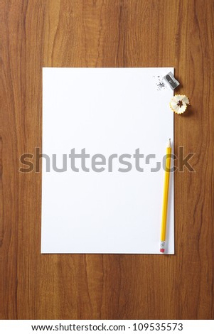 Back to School pupils art pad and pencil on wooden school desk shot above - stock photo