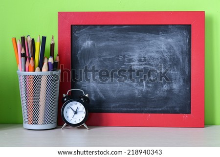 Back to school.school tools on a wooden shelf. A wooden background. - stock photo