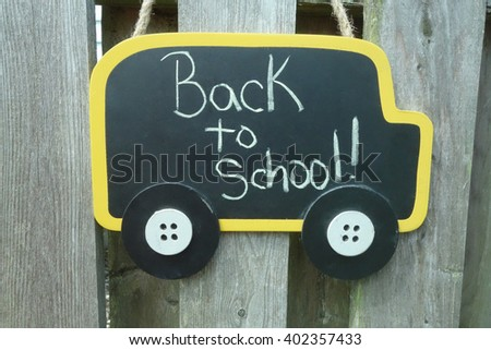 back to school sign in shape of school bus - stock photo