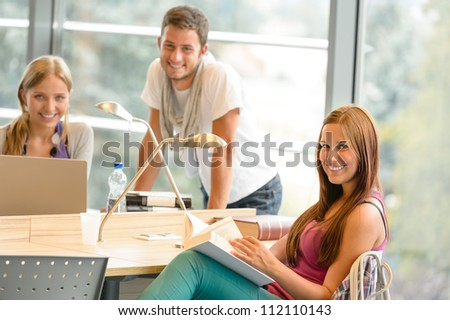 Back to school students studying in library smiling learning education - stock photo